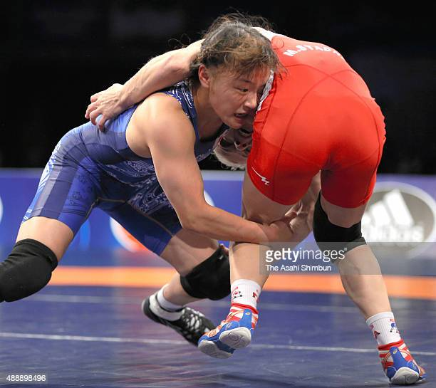 Eri Tosaka of Japan and Mariya Stadnyk of Azerbaijan compete in the Women's Freestyle 48kg final during day three of the World Wrestling...
