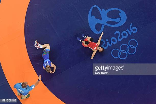 Eri Tosaka of Japan celebrates winning gold against Mariya Stadnik of Azerbaijan in the Women's Freestyle 48kg event on Day 12 of the Rio 2016...