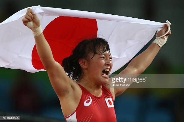 Eri Tosaka of Japan celebrates winning the gold medal in the Women's Freestyle 48 kg in the wrestling competition on day 12 of the Rio 2016 Olympic...