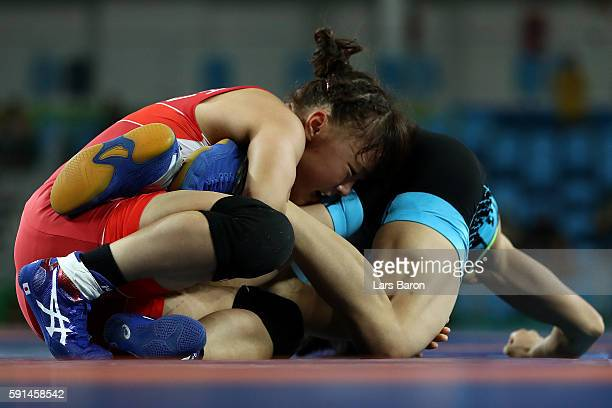 Eri Tosaka of Japan competes against Yanan Sun of China during a Women's Freestyle 48kg Semifinal bout on Day 12 of the Rio 2016 Olympic Games at...
