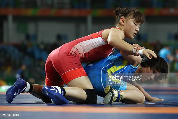 Eri Tosaka of Japan competes against Zhuldyz Eshimova of Kazakhstan during a Women's Freestyle 48kg 1/8 Final bout on Day 12 of the Rio 2016 Olympic...