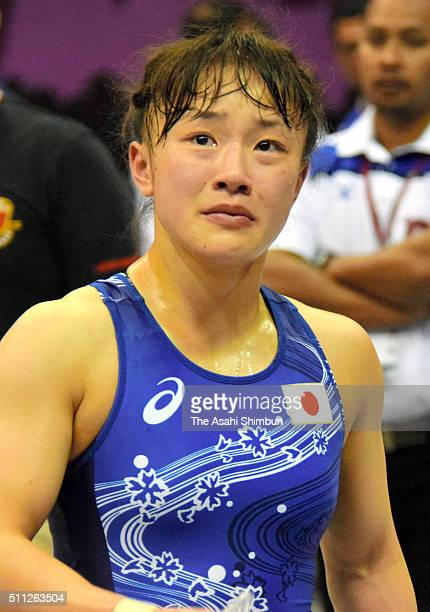 Eri Tosaka of Japan sheds tears after her defeat by Sun Yanan of China in the Women's Freestyle Senior 48 kg semi final match during the 2016...