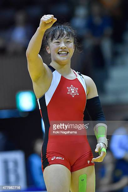 Eri Tosaka rises her arm in winning the Women's 48kg free style final match against Yuki Irie during All Japan Wrestling Championships at Yoyogi...