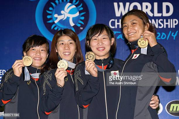 Eri Tosaka Saori Yoshida Chiho Hamada and Kaori Icho of Japan pose for their gold medals during day four of the FILA World Wrestling Championship at...