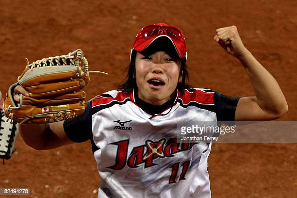 Eri Yamada of Japan celebrates Japan's 31 win against the United States during the women's grand final gold medal softball game at the Fengtai...