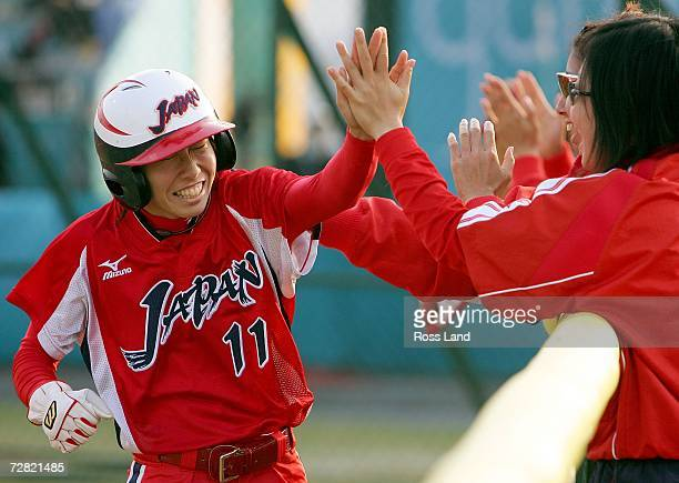Eri Yamada of Japan celebrates scoring with team mates during the Gold Medal Game against Chinese Taipei at the 15th Asian Games Doha 2006 at the...