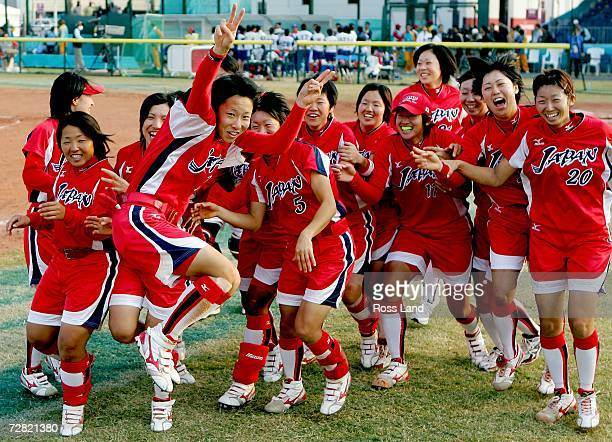 Eri Yamada of Japan celebrates with her team after winning the gold medal in the game against Chinese Taipei at the 15th Asian Games Doha 2006 at the...