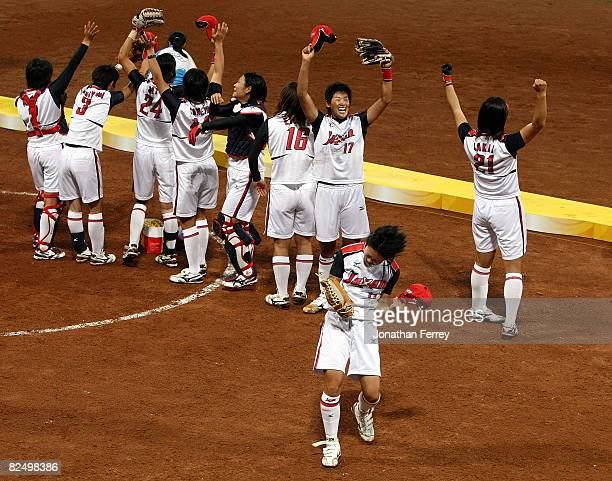Eri Yamada of Japan celebrates with her teammates after their 31 win against the United States during the women's grand final gold medal softball...