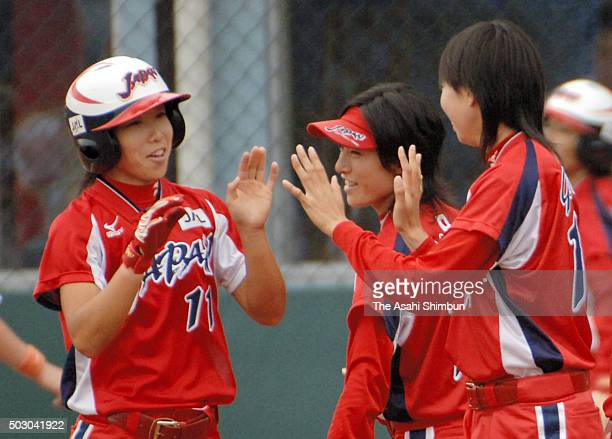Eri Yamada of Japan is congratulated after hitting a solo homer in the bottom of first inning during the Softball Women's World Championship Group B...