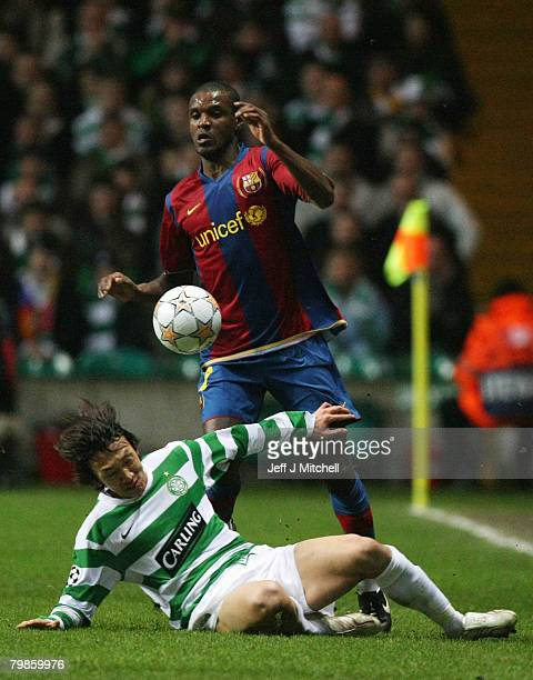 Eric Abidal of Barcelona is challenged by Shunsuke Nakamura of Celtic during the UEFA Champions League First Knockout Round First Leg match between...