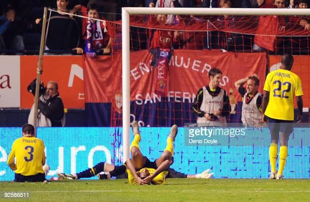 Eric Abidal of Barcelona looks dejected after Osasuna scored the equalizing goal during the La Liga match between Barcelona and Osasuna at Estadio...