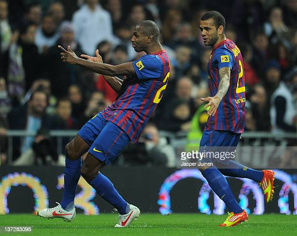 Eric Abidal of FC Barcelona celebrates with his teammate Daniel Alves after scoring his sides second goal during the Copa del Rey quarter final match...