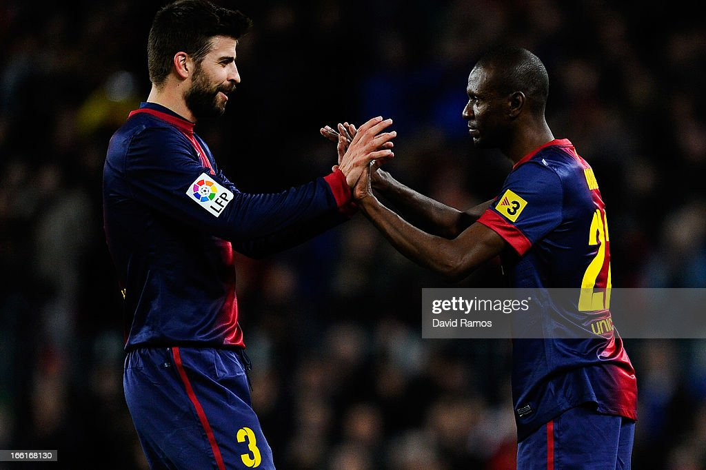 <a gi-track='captionPersonalityLinkClicked' href=/galleries/search?phrase=Eric+Abidal&family=editorial&specificpeople=469702 ng-click='$event.stopPropagation()'>Eric Abidal</a> of FC Barcelona comes on for <a gi-track='captionPersonalityLinkClicked' href=/galleries/search?phrase=Gerard+Pique&family=editorial&specificpeople=227191 ng-click='$event.stopPropagation()'>Gerard Pique</a> of FC Barcelona during the La Liga match between FC Barcelona and RCD Mallorca at Camp Nou on April 6, 2013 in Barcelona, Spain.