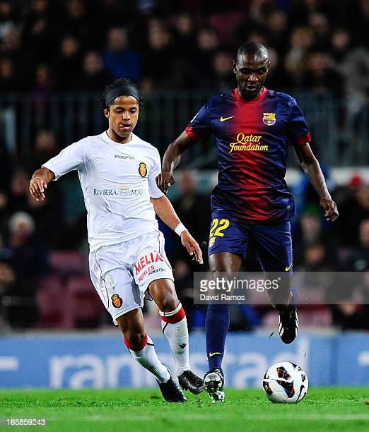 Eric Abidal of FC Barcelona duels for the ball with Giovani dos Santos of RCD Mallorca during the La Liga match between FC Barcelona and RCD Mallorca...