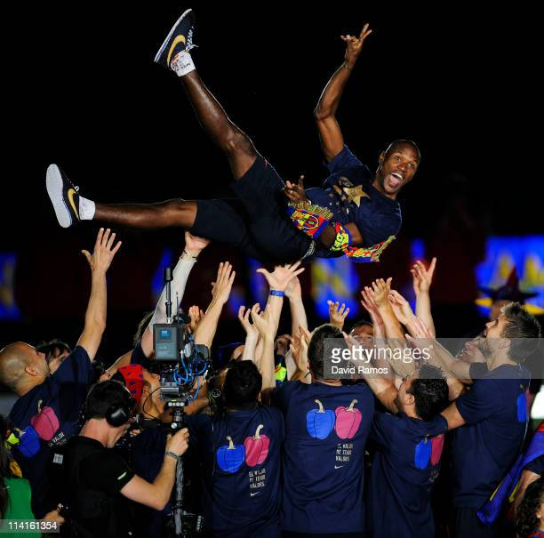 Eric Abidal of FC Barcelona is lifted by his teammates during the celebrations for winning the Spanish Liga at the Camp Nou Stadium on May 13 2011 in...