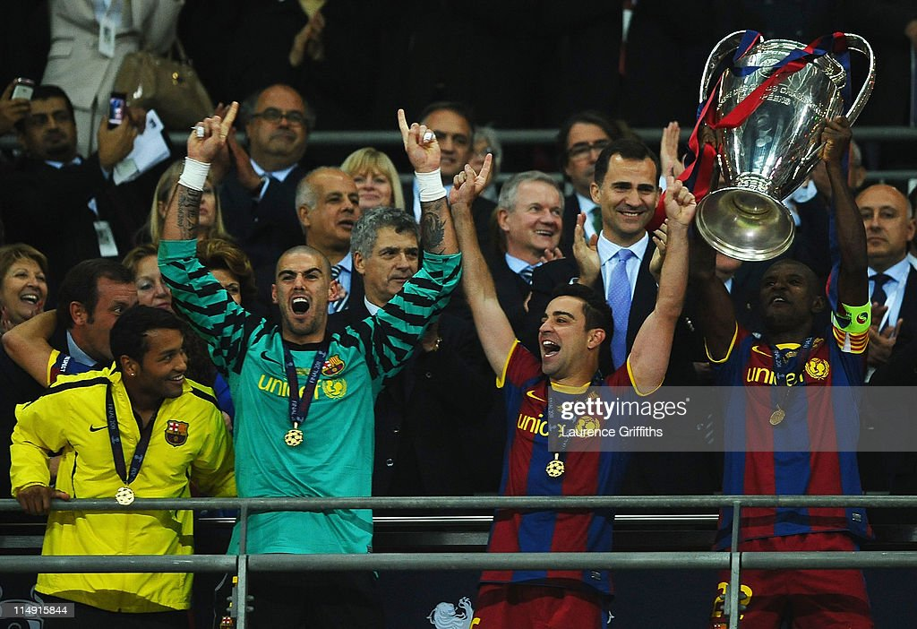 <a gi-track='captionPersonalityLinkClicked' href=/galleries/search?phrase=Eric+Abidal&family=editorial&specificpeople=469702 ng-click='$event.stopPropagation()'>Eric Abidal</a> (R) of FC Barcelona lifts the trophy after victory in the UEFA Champions League final between FC Barcelona and Manchester United FC at Wembley Stadium on May 28, 2011 in London, England.