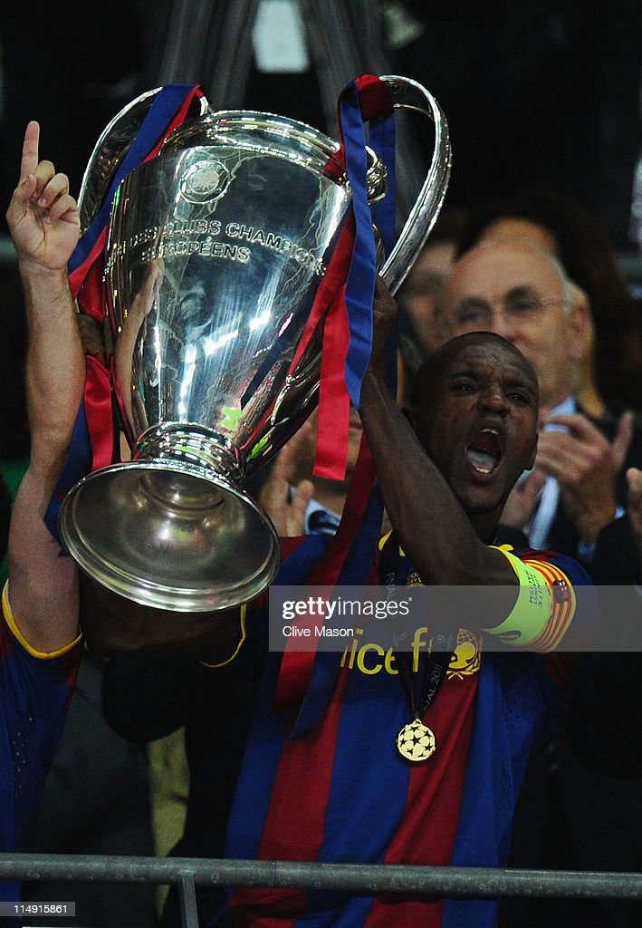 Eric Abidal of FC Barcelona lifts the trophy after victory in the UEFA Champions League final between FC Barcelona and Manchester United FC at Wembley Stadium on May 28, 2011 in London, England.