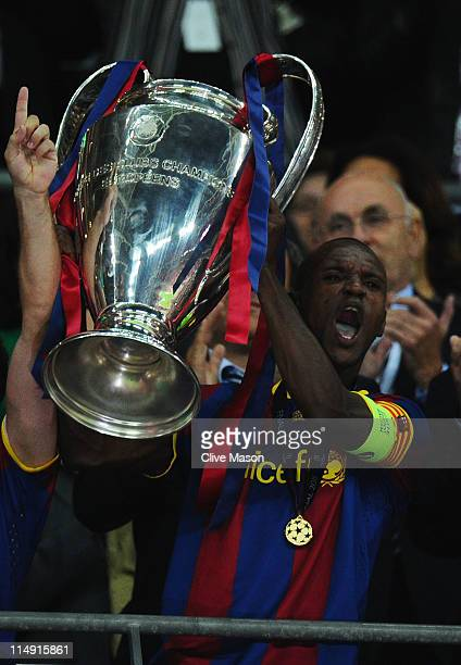 Eric Abidal of FC Barcelona lifts the trophy after victory in the UEFA Champions League final between FC Barcelona and Manchester United FC at...
