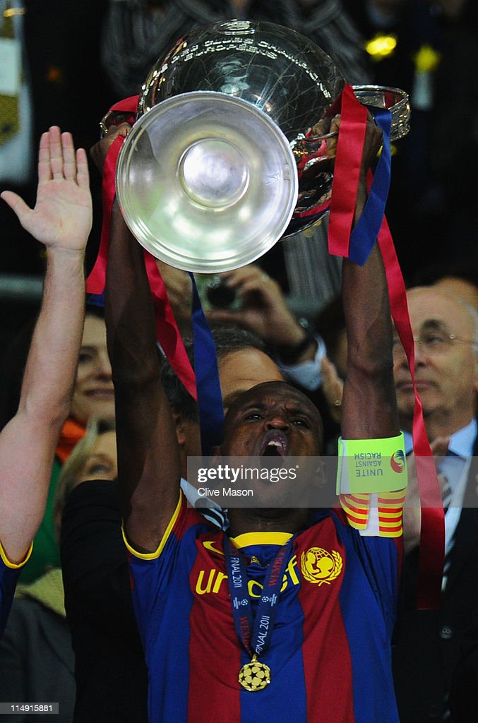 <a gi-track='captionPersonalityLinkClicked' href=/galleries/search?phrase=Eric+Abidal&family=editorial&specificpeople=469702 ng-click='$event.stopPropagation()'>Eric Abidal</a> of FC Barcelona lifts the trophy after victory in the UEFA Champions League final between FC Barcelona and Manchester United FC at Wembley Stadium on May 28, 2011 in London, England.