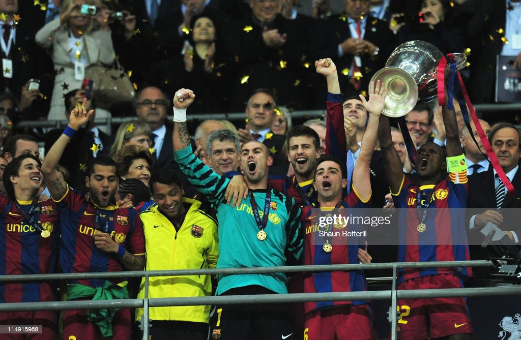 <a gi-track='captionPersonalityLinkClicked' href=/galleries/search?phrase=Eric+Abidal&family=editorial&specificpeople=469702 ng-click='$event.stopPropagation()'>Eric Abidal</a> (R) of FC Barcelona lifts the trophy and celebrates with teammates after victory in the UEFA Champions League final between FC Barcelona and Manchester United FC at Wembley Stadium on May 28, 2011 in London, England.