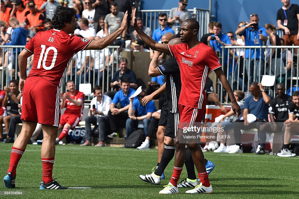 Eric Abidal (R) of World All-Stars celebrates his goal with team mate Rai during the Ultimate Champions Match between Milan & Inter Legends and World All-Stars during the Champions Festival prior to the final at Stadio Giuseppe Meazza on May 27, 2016 in Milan, Italy.
