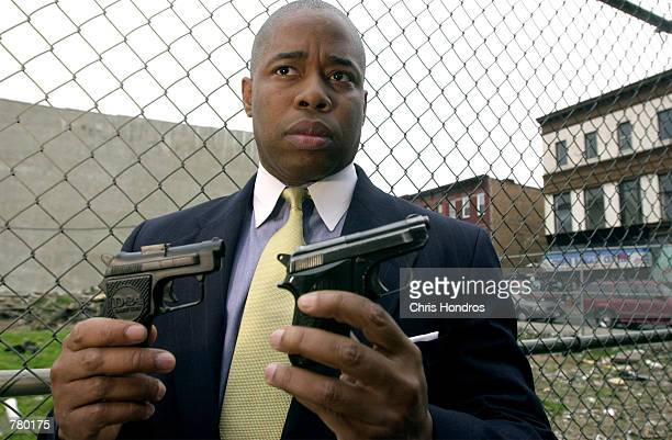 Eric Adams a lieutenant in the New York Police Department and cofounder of 100 Black Men in Law Enforcement organization holds up a toy gun left and...