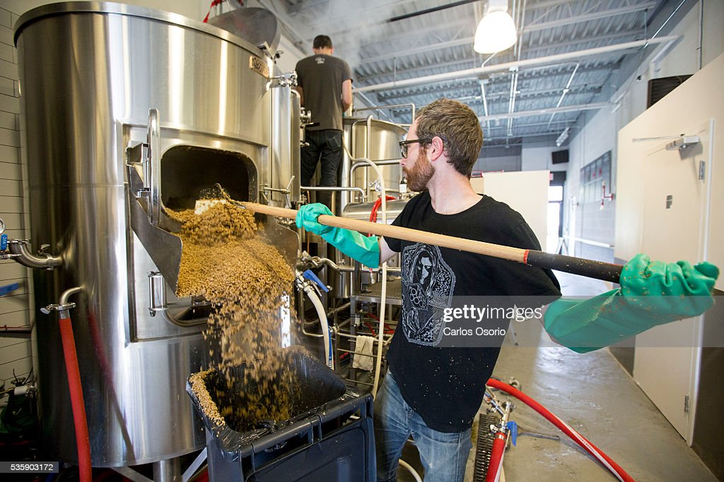 TORONTO, ON - MAY Eric and Callum during the brewing process. Callum Hay and Eric Portelance (glasses) are the co-founders of Halo Brewery in Toronto. May 30, 2016. For story on how craft breweries are banding together to survive, sharing ingredients and passing around knowledge