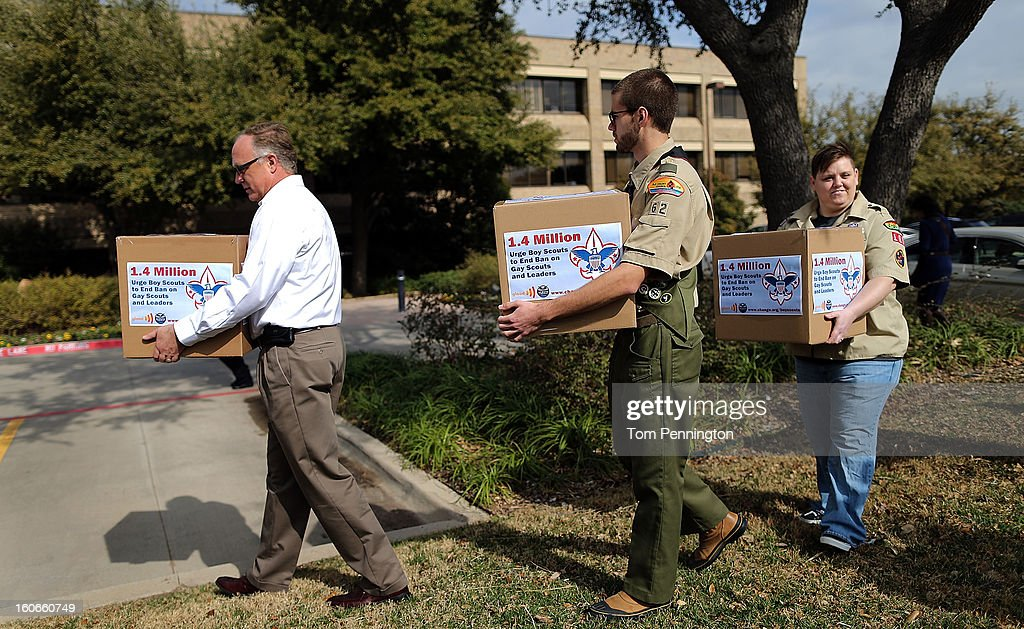 Eric Andresen, former Scout leader, Will Oliver, Eagle Scout, and Jennifer Tyrrell, former Cub Scout Den Mother, deliver signatures urging the Boy Scouts of America to reverse the orginazition's ban on LGBT Scouts organization's ban on LGBT Scouts on February 4, 2013 in Irving, Texas. The BSA national council announced they were considering to leave the decision of inclusion of gays to the local unit level. U.S. President Barack Obama urged the organization to end a ban on gays.