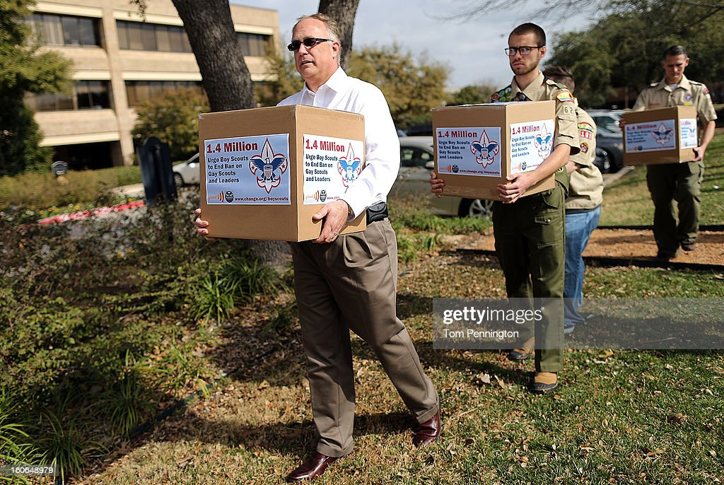 Eric Andresen, former Scout leader, Will Oliver, Eagle Scout, Jennifer Tyrrell, former Cub Scout Den Mother, and Greg Bourke, former Assistant Scoutmaster, deliver boxes containing 1.4 million signatures urging the Boy Scouts of America to reverse the organization's ban on LGBT Scouts on February 4, 2013 in Irving, Texas. The BSA national council announced they were considering to leave the decision of inclusion of gays to the local unit level. U.S. President Barack Obama urged the organization to end a ban on gays.