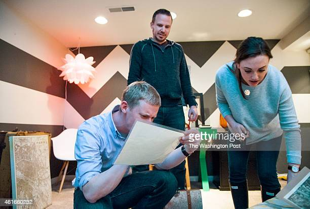 Eric Arnold Matt Leedham and Cassie Young attempt to gather clues and solve the puzzles at Escape Room Live DC January 12 2015 in Washington DC