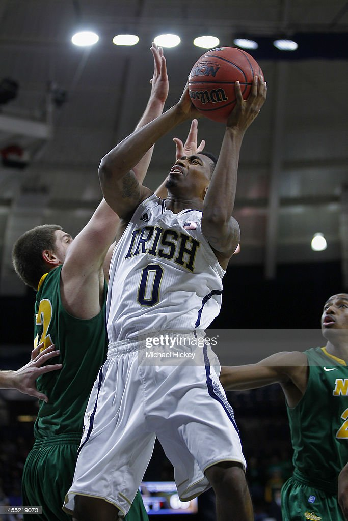 Eric Atkins #0 of the Notre Dame Fighting Irish at Purcel Pavilion shoots the ball against Marshall Bjorklund #42 of the North Dakota State Bison on December 11, 2013 in South Bend, Indiana. North Dakota State defeated Notre Dame 73-69.