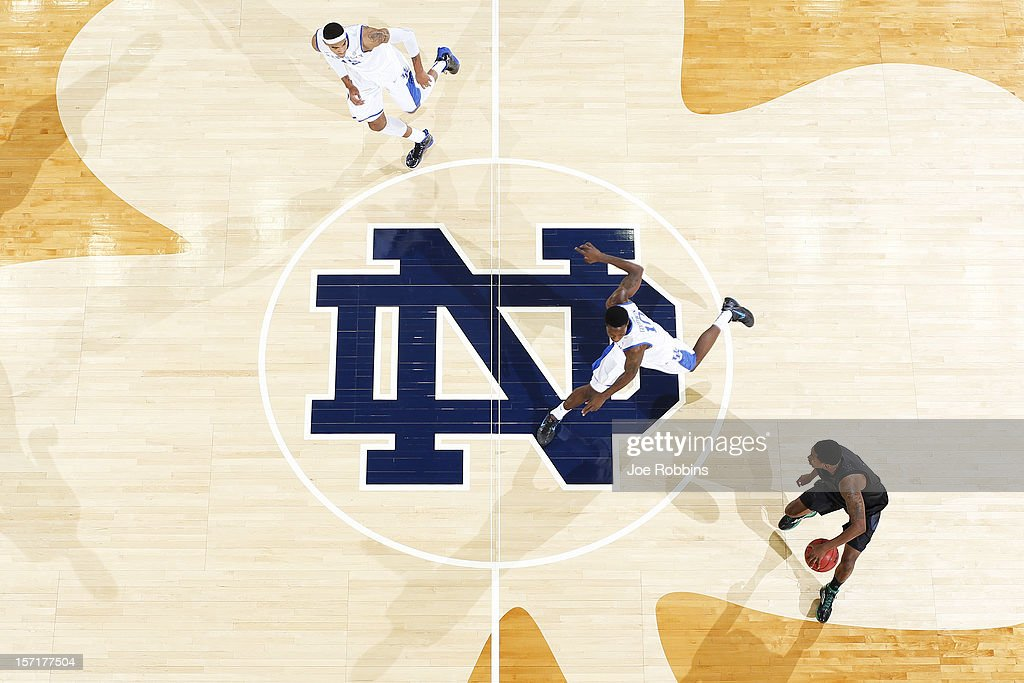 Eric Atkins #0 of the Notre Dame Fighting Irish brings the ball up court against Archie Goodwin #10 of the Kentucky Wildcats during the game at Purcell Pavilion at the Joyce Center on November 29, 2012 in South Bend, Indiana. Notre Dame won 64-50.