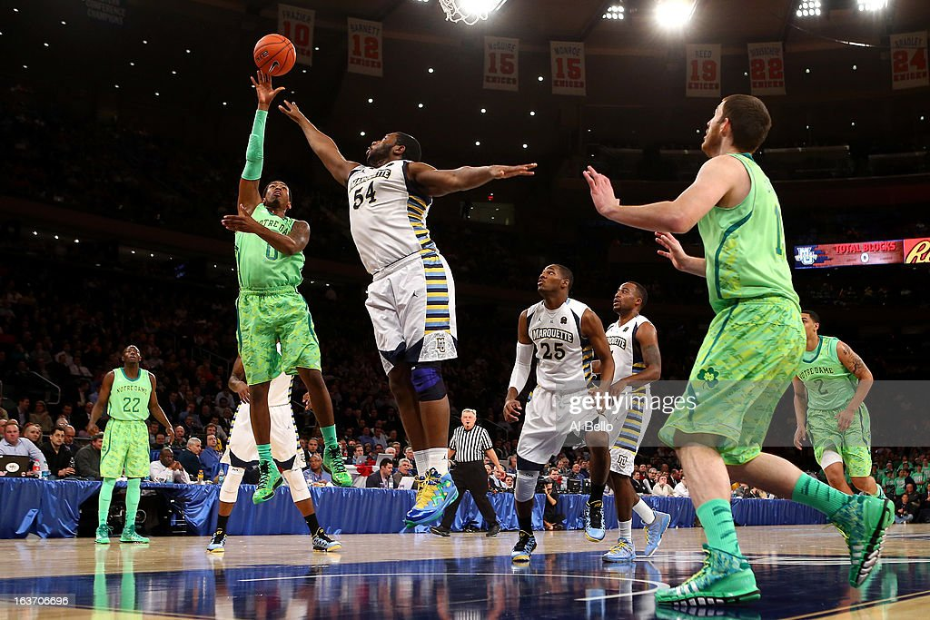 Eric Atkins #0 of the Notre Dame Fighting Irish drives for a shot attempt against Davante Gardner #54 of the Marquette Golden Eagles during the quaterfinals of the Big East Men's Basketball Tournament at Madison Square Garden on March 14, 2013 in New York City.