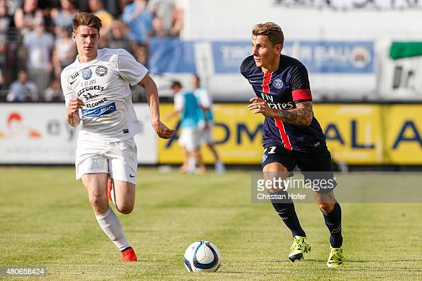 Eric Auss of Wiener Sportklub competes for the ball with Lucas Digne of Paris SaintGermain during the Friendly Match between Wiener Sportklub and...
