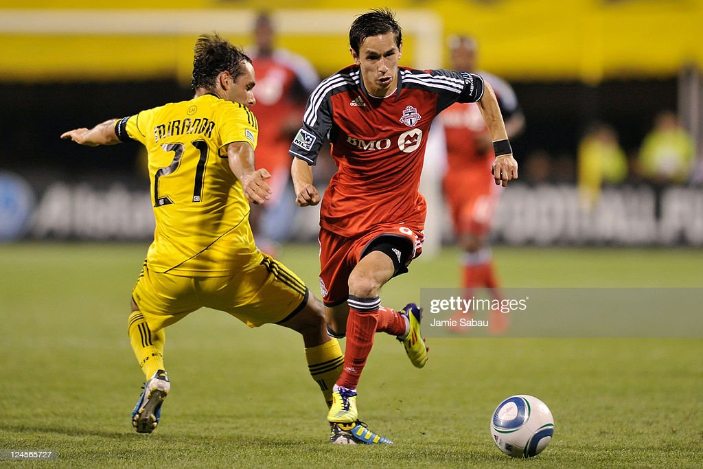 Eric Avila #8 of Toronto FC runs past Sebastian Miranda #21 of the Columbus Crew as he controls the ball in the first half on September 10, 2011 at Crew Stadium in Columbus, Ohio. Toronto FC defeated Columbus 4-2 to take the Trillium Cup for the first time.