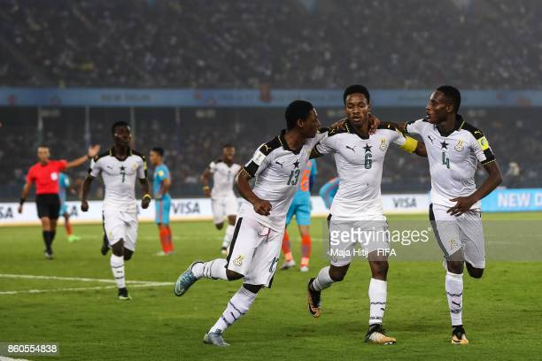 Eric Ayiah of Ghana celebrates with his teammates after scoring his team's first goal to make it 10 during the FIFA U17 World Cup India 2017 group A...