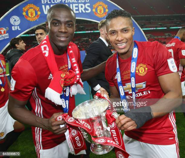 Eric Bailly and Antonio Valencia of Manchester United celebrate after the EFL Cup Final match between Manchester United and Southampton at Wembley...