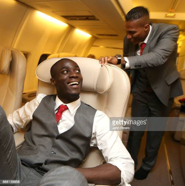 Eric Bailly and Antonio Valencia of Manchester United celebrate on the plane home after the UEFA Europa League Final match between Manchester United...