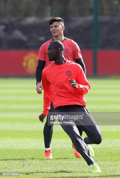 Eric Bailly and Marcos Rojo of Manchester United in action during a first team training session at Aon Training Complex on March 15 2017 in...