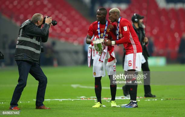 Eric Bailly and Paul Pogba of Manchester United pose for a photo with the trophy during the EFL Cup Final match between Manchester United and...