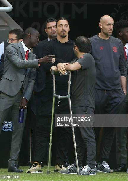 Eric Bailly and Zlatan Ibrahimovic of Manchester United watch the warmup from the sidelines ahead of the UEFA Europa League Final match between...