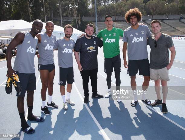 Eric Bailly Ashley Young Juan Mata Joel Pereira and Marouane Fellaini of Manchester United pose with Game of Thrones actors John BradleyWest and Joe...