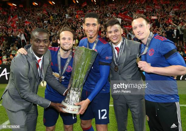 Eric Bailly Daley Blind Chris Smalling Marcos Rojo and Phil Jones of Manchester United celebrate with the Europa League trophy after the UEFA Europa...