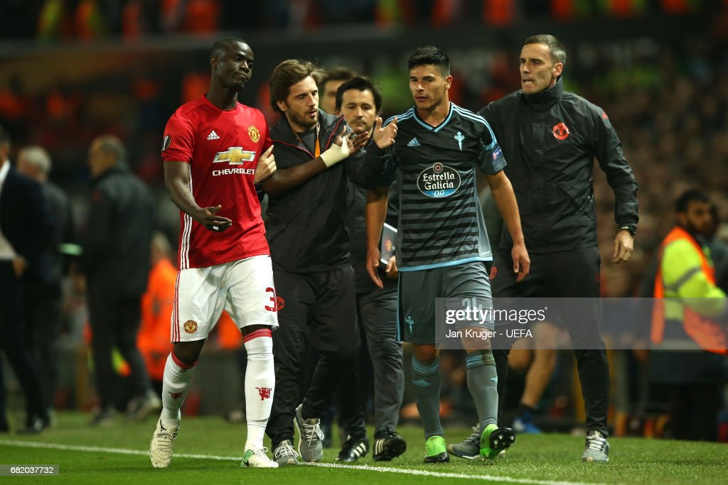 Eric Bailly of Manchester United and Facundo Roncaglia of Celta Vigo leave the pitch after they are both shown a red card during the UEFA Europa League, semi final second leg match, between Manchester United and Celta Vigo at Old Trafford on May 11, 2017 in Manchester, United Kingdom.