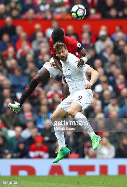 Eric Bailly of Manchester United and Fernando Llorente of Swansea City battle to win a header during the Premier League match between Manchester...