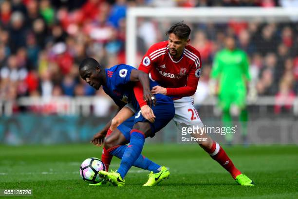 Eric Bailly of Manchester United and Gaston Ramirez of Middlesbrough battle for possession during the Premier League match between Middlesbrough and...