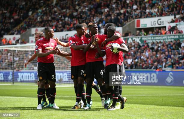 Eric Bailly of Manchester United celebrates after he scores a goal to make it 01 with his team mates during the Premier League match between Swansea...