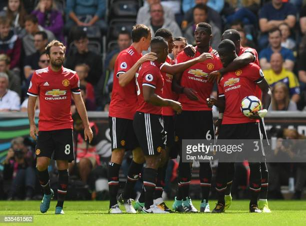 Eric Bailly of Manchester United celebrates scoring his sides first goal with his Manchester Untited team mates during the Premier League match...
