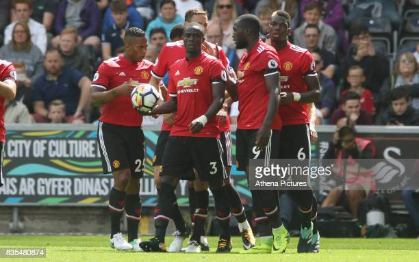 Eric Bailly of Manchester United celebrates scoring his sides first goal of the match during the Premier League match between Swansea City and...