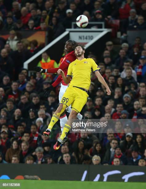 Eric Bailly of Manchester United in action with Aleksandr Erokhin of FK Rostov during the UEFA Europa League Round of 16 second leg match between...
